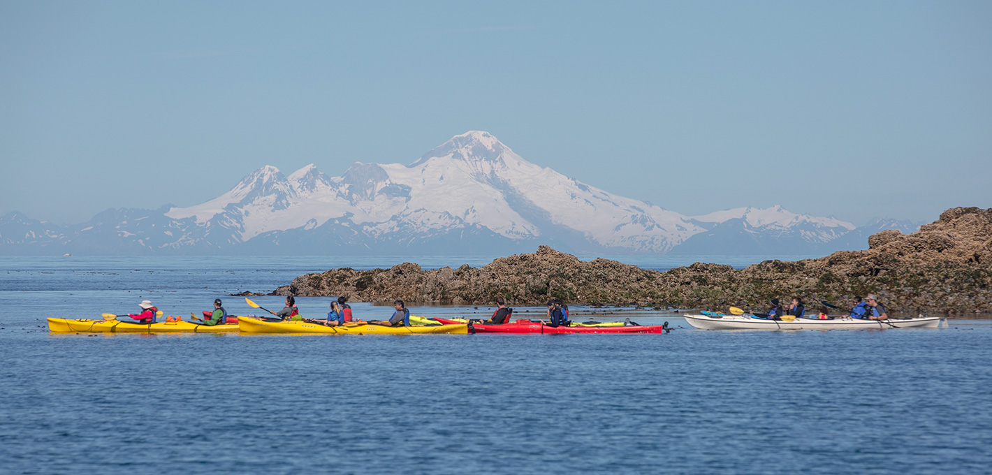 View Mount Iliamna while sea kayaking in Kachemak Bay with St. Augustine's Kayak and Tours - Homer, Alaska